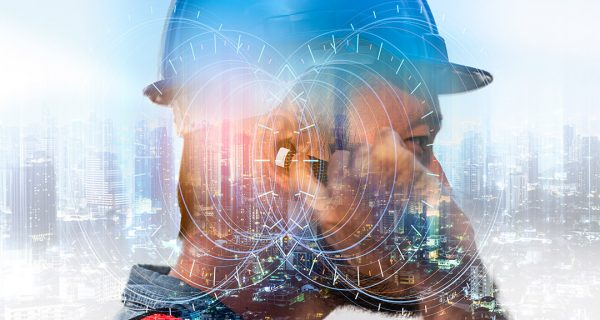 The double exposure image of the engineer use headset overlay with night cityscape image and futuristic hologram. The concept of telecom,5g,engineering, construction, city life and future.